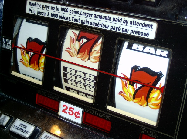 "The famous ""near miss"" on a slot machine."