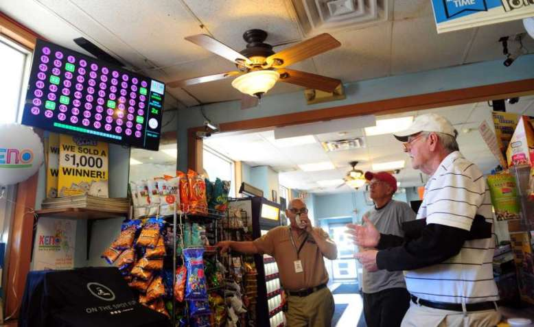 Customers play a round of keno at Daybreak Doughnuts in Bridgeport